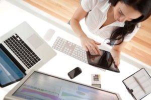 Businesswoman at her desk using a digital tablet