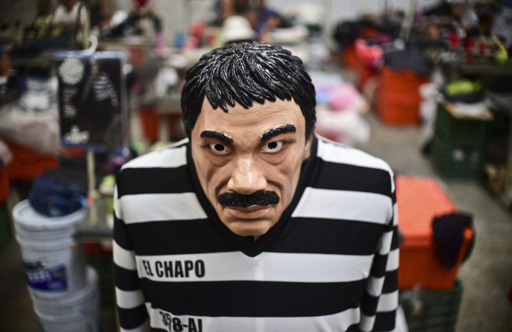 A costume and a mask representing Mexican drug trafficker Joaquin Guzman Loera, aka