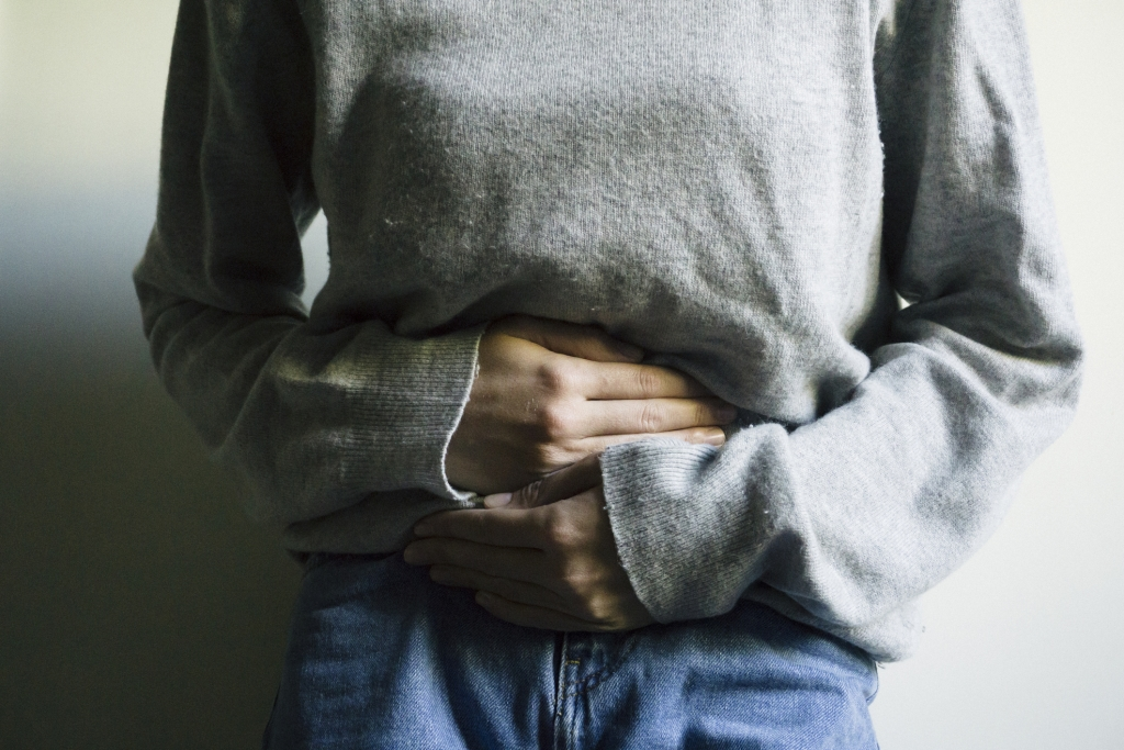 Woman suffering from stomach ache